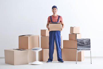 Delivery man holding box, indoors