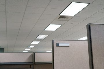 office cubicle and room ceiling with lamp
