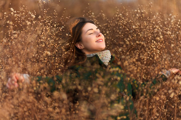 Portrait of a beautiful young woman in a field