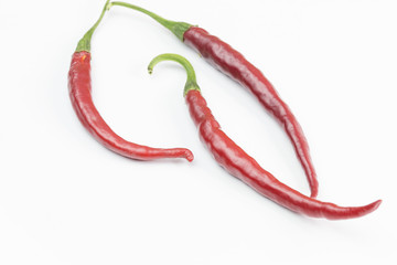 Red peppers isolated on a white background.