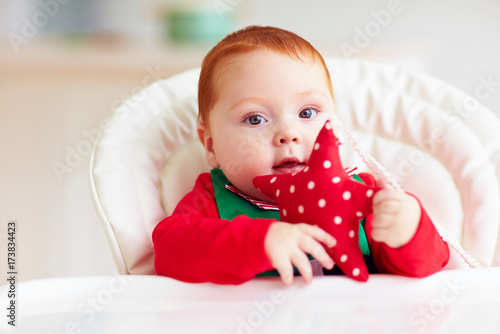 508593d2a152 cute infant redhead baby boy in elf costume sitting in highchair at ...