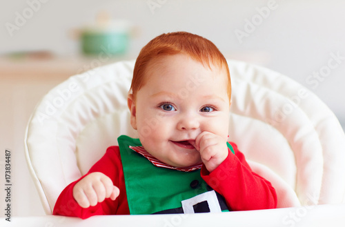 49482e798d03 cute infant redhead baby boy in elf costume playing with red star in ...