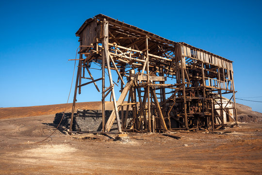 Abandoned wooden machinery of salt mine cableway, Cape Verde, Africa