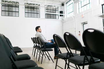 Young man sitting in an auditorium