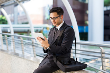Young asian businessman working outdoors