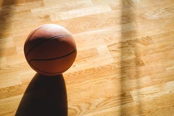 High angle view of basketball on hardwood floor