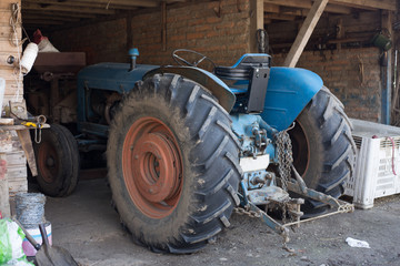 Agricultural machinery and equipment in the farm garage