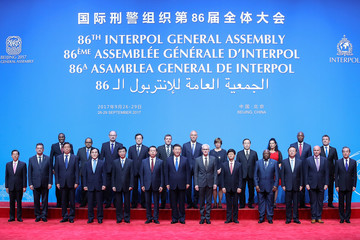 Chinese President Xi Jinping with Secretary General of Interpol Jurgen Stock and Meng Hongwei, president of Interpol pose for a group photo before the 86th INTERPOL General Assembly at Beijing National Convention Center