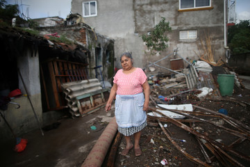 Antonia Vergara, 75, poses for a photo on the place where her house was after an earthquake in Axochiapan, at the epicenter zone