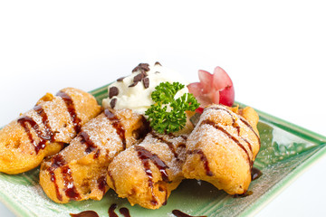 Thai dessert Deep fried banana with whipping cream and chocolate sauce