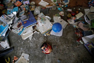 Debris is pictured on the floor of a house after an earthquake in San Juan Pilcaya, at the epicenter zone