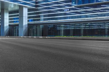 empty asphalt road front of modern buildings at dusk