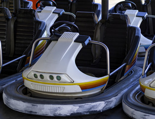 Luna park stopped: daughter in bumper car at fun fair