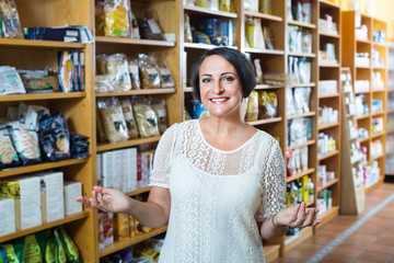 Woman shopping health supplements in drugstore