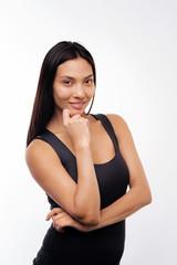 Beautiful woman posing in a black tank top