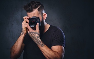A man taking picture with a professional camera.