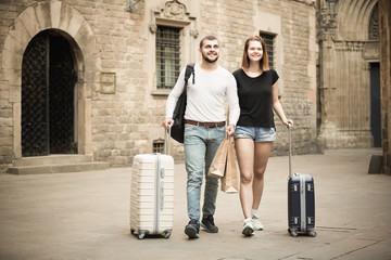 Charming man and woman going the historic city center