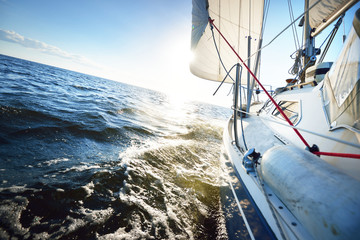 View forward from a sailboat tilted by the wind