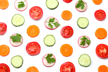mix of sliced cucumber with sliced carrot and tomato isolated on a white background top view