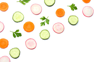 mix of sliced cucumber with sliced carrot isolated on a white background top view