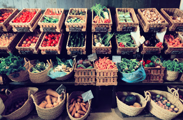 Zelfklevend Fotobehang Groenten vegetables and fruits in wicker baskets in greengrocery