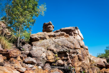 Rock formation looking like a monster with a small head on Leilyn Trail, Katherine, Australia,