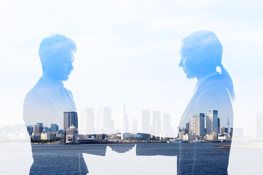 Business partnership concept. Multiple exposure.