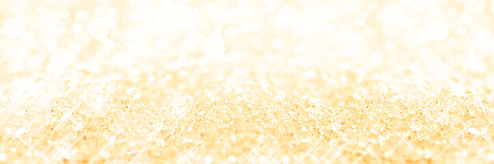 Panoramic golden background of snow, holiday glittering background