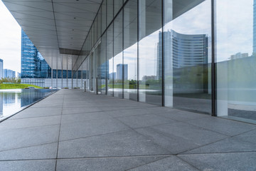 modern office building reflected on clean glass wall, china..