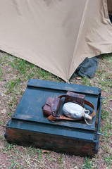 old war briefcase in front of a military tent