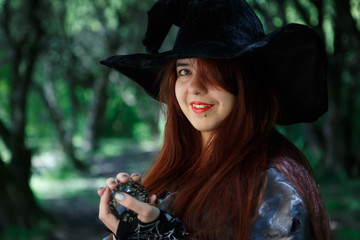 Portrait of witch in black hat