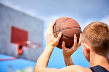 male playing basketball outdoor