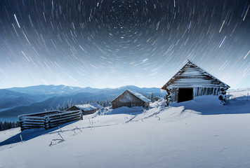 chalets in the mountains at night under the stars. Magic event in frosty day. In anticipation of the holiday. Dramatic scenes