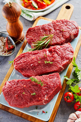 Deurstickers Vlees Slices of raw meat prepared on cutting board