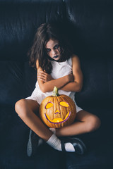 Malicious girl with pumpkin halloween