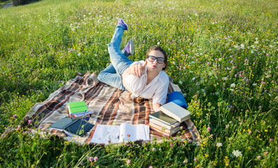 Young caucasian woman reading a book outdoor