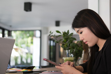 Printed kitchen splashbacks Bonsai businesswoman use mobile phone at workplace. young woman texting message on smart phone at office. freelancer use cellphone for online network connection at cafe coffee shop.
