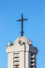 black cross on top of a church