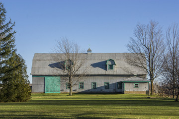 farm building with green grass and blue sky