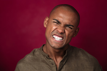 Close up portrait of angry african man looking at camera