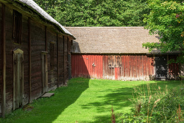 Two barns meet in the corner of a farm yard.