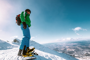 Snowboarder stay on the mountain top