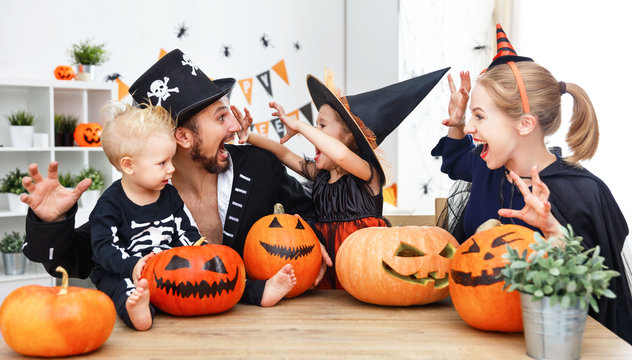 happy family mother father and children in costumes   on  Halloween