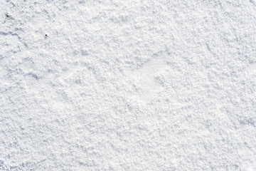 Clean snow texture, winter background, white surface with snowflakes