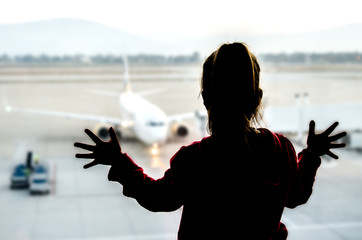 The little girl looks with interest at her plane before the flight.