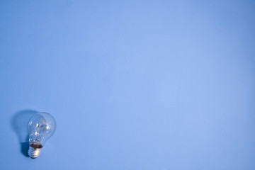 abstract wide angle electric bulb on blue wall