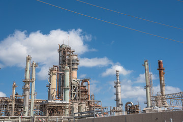 Oil refinery, oil factory, petrochemical plant in Corpus Christi, Texas, USA, cloud blue sky.