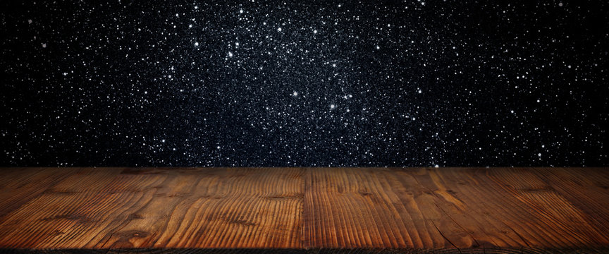 Abstract starry sky background with wooden stage