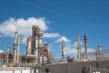 Oil refinery, oil factory, petrochemical plant in Corpus Christi, Texas, USA, cloud blue sky.