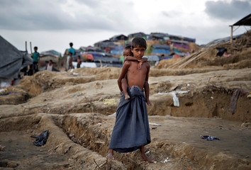 Rohingya refugee children pose for a picture in a camp at Cox's Bazar